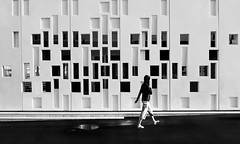 human in geometry (christikren) Tags: walking architecture blackwhite bw christikren contrast facade geometry lines sw canon street streetphotography digital urban candid building black pier puddle