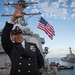 Chief Gunner's Mate Francis Cruz waves as USS Jason Dunham (DDG 109) pulls into Naval Station Norfolk.