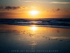 Thursday Night (stewartbaird) Tags: spring beach newzealand sunset sand gold sky seascape red landscape clouds sea