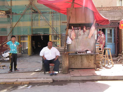 A butcher and his son, Kashgar, Xinjiang, China