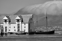Fishermen end... (Zoom58.9) Tags: building house sea boats fisherboat water clouds sky rocks mountain bw canon eos 50d