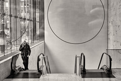 'Up and Down, Round and Round' (Canadapt) Tags: man phone escalator circle window building interior bw wall toronto canadapt