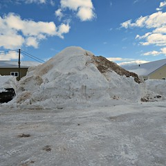 Just a bit of snow (clickclique) Tags: snow pile snowpile winter white snirt sky clouds blue apartments cold inexplore