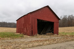 James Bell Corn Crib — Pleasant Township, Knox County, Ohio (Pythaglio) Tags: barn outbuilding structure historic rural farm agriculture vertical boards painted mountvernon ohio unitedstates us trees field farmland road jamesbell pleasanttownship knoxcounty clouds