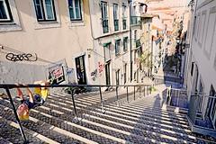 Portugal (kirstiecat) Tags: portugal lisbon lisboa kid shadows stairs steps diagonal street canon dimension landscape architecture strangers people
