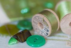 Sewing Notions (JMS2) Tags: macromondays green theme sewing notions button macro closeup thread bokeh spool canon