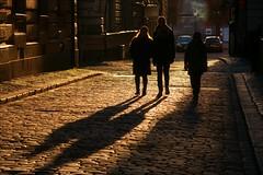 Streets of Gold (*Kicki*) Tags: stockholm gamlastan sweden oldtown fotofikapromenad autumn street candid silhouettes shadows people goldenhour city evening