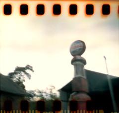 Sur la route du Mont Gargan. (matériel brouilleur) Tags: diana multi pinhole sténopé lensless 35mm sprocket lomo lomography stationservice gasstation montgargan