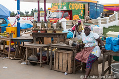 Street vendor (10b travelling / Carsten ten Brink) Tags: 10btravelling 2017 accra africa african afrika afrique carstentenbrink elmina ghana ghanaian goldcoast gulfofguinea iptcbasic places westafrica coast fruit pineapple shore streetvendor tenbrink vendor women
