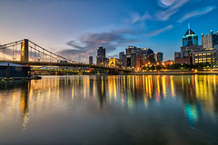 Peaceful Pittsburgh (tquist24) Tags: alleghenyriver hdr nikon nikond5300 outdoor pennsylvania pittsburgh robertoclementebridge bridge city clouds downtown geotagged lights longexposure morning reflection reflections river sky skyscraper sunrise water
