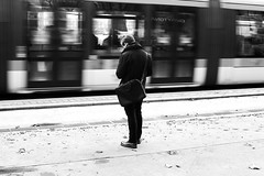 In front of the train (pascalcolin1) Tags: paris13 homme train man tramway tram photoderue streetview urbanarte noiretblanc blackandwithe photopascalcolin 50mm canon50mm canon