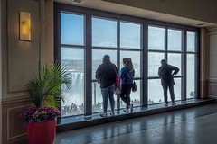 The Big Picture (Wes Iversen) Tags: canada canadian hww horseshoefalls niagarafalls nikkor24120mm windowwednesday ferns flowerpots flowers interior men people plants reflections waterfalls windows women