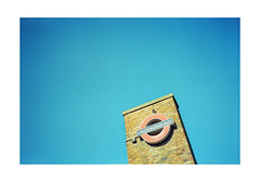 overground (Christopher Burdon) Tags: sign bluesky negativespace laf35 nikon ektar colour ealing tube underground london
