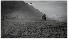 Just The Two Of Us (Christina's World!) Tags: blackandwhite bw monochrome morninglight mood moody beach ocean sandiego scenic sky streetphotography sea hat man woman youngwoman youngman water waves waterscene walking fence palmtree hills pacificocean sand couple dreamy dramatic portrait realpeople mist landscape exhibitionoftalent fragiletouch