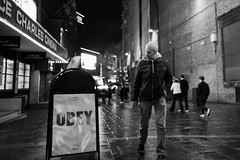 21,397M (Panda1339) Tags: 28mm man monochrome cinematic ldn chinatown streetphotography london sign leicesterplace uk light