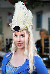 Feathered Hat (wyojones) Tags: texas galveston dickensonthestrand holidayfestival hat dress blonde hair girl lady lovely woman beautiful beauty feathers smile pretty curls jacket plumes blueeyes