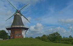 Greetsiel_045 (rhomboederrippel) Tags: rhomboederrippel june 2018 fujifilm xe1 europe germany lowersaxony greetsiel sky blue green windmill cloud