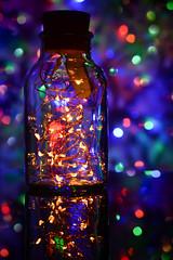Bokeh in a Bottle (flashfix) Tags: december042018 2018inphotos flashfix flashfixphotography ottawa ontario canada nikond7100 40mm bokehparty bokeh bottle cap tree christmas lights colourful colours lines holiday seasonal shine