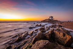 God's lighthouse (Artur Tomaz Photography) Tags: people yellow beach chapel dof orange portugal pov religious rocks sea senhordapedra sun sunset