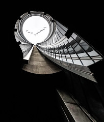 Where Does The Real World Start by Simon Hadleigh-Sparks (Simon Hadleigh-Sparks) Tags: abstract architecture art building city contrast composition conceptual circle distorted diagonal keyhole london lines curve metal pattern passage round simonandhiscamera urban