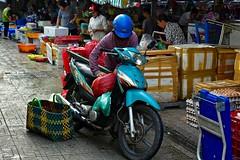 Loading Up:  Next Purchase - Eggs (Ginger H Robinson) Tags: loading motorcycle purchase eggs early morning benthanhmarket market large historic landmark saigondistrict1 hcmc vietnam southeastasia vendor patron streetphotography