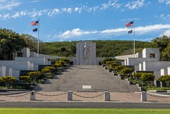 National Memorial Cemetery of the Pacific (Karen_Chappell) Tags: travel cemetery honolulu oahu canonef24105mmf4lisusm graves graveyard hawaii usa landscape city trees blue green memorial monument statue flags steps stairs staircase clouds sky
