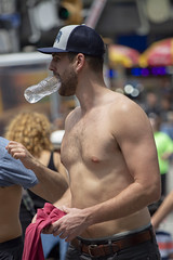 094A2697 v2 (Wheels Down) Tags: guy male shirtless barechest water bottle cap streetphotography candid nyc beard