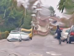 REGNERISCH UND STÜRMIG 20190314_125251 (2) (hlh 1960) Tags: regen rain wetter sturm wind outdoor strasse street autos woman frau regenschirm umbrella märz march unwetter verzerrung tree tanne farben colour spring frühling springtime