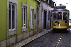 28 Squeeze (Douguerreotype) Tags: people lisbon tracks cobblestones tram lisboa buildings street yellow architecture city portugal urban rails wall