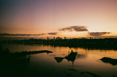 Dusk (ewitsoe) Tags: analogue kodakgold nikonfm2 street erikwitsoe erikwitsoecom poland urban kodakgold400 film filmseries night dusk eveneing river reflection sunset cold cityscape analog