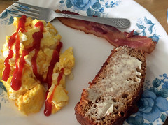 Scrambled Eggs, Bacon And Amish Friendship Bread. (dccradio) Tags: lumberton nc northcarolina robesoncounty indoor indoors inside food eat breakfast meal apple ipad mini2 january winter monday mondaymorning morning goodmorning eggs ketchup catsup scrambledeggs bacon amishfriendshipbread buttered butter quickbread corelle plate fork silverware