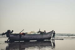 Fishermen heading out to sea with a helping hand (nahinmiah93) Tags: beach boat boats sea sky fishermen people peaceful nature beautiful goa sand scene india vacation sunny seaside coast shore