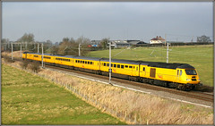'Barby' goes Bananas! (Jason 87030) Tags: 43015 barby herbie vw yellow flying fast speed 125 hst highspeedtrain paint test networkrail clever 2009 january wcml westcoastmainline barbynortoft lineside canon eos tren train color colour shape 20d old frame border ts nmt newmeasurementtrain tracks railway uk england