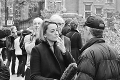 """You've got something on your mouth"".... (markwilkins64) Tags: london streetphotography street candid photojournalism markwilkins mark mono monochrome blackandwhite bw collegegreen housesofparliament uk"