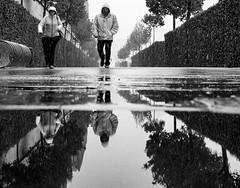 Refreshment (CoolMcFlash) Tags: street streetphotography people vienna candid wet rain rainy reflection puddle bnw blackandwhite bw fujifilm x30 strase personen wien wasser water nass regen wetter spiegelung pfütze sw schwarzweis fotografie photography cold kalt