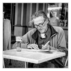 Crossword puzzle (sdc_foto) Tags: sdcfoto street streetphotography bw blackandwhite man table beer crossword france people pentax k1
