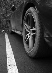 Alloy (Shaka1277) Tags: fuji fujifilm fujicron xt2 23mm mirrorless monochrome monochromatic blackandwhite car mercedes leadingline leadinglines wheel rim alloy vehicle