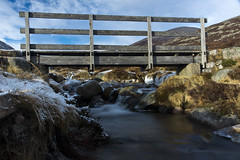 Bridge Over Troubled Water (steve_whitmarsh (catching up after India)) Tags: aberdeenshire scotland scottishhighlands highlands ice waterfall rocks longexposure mountain hills bridge fence water stream burn glen topic