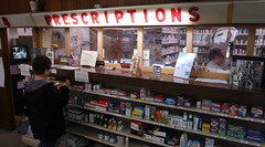 Burden (left) works in the front of the store while Carpenter works in the back where the pharmacy is located.