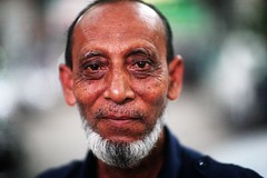 The Old Macaque (N A Y E E M) Tags: securityguard portrait dusk street mimisupermarket chittagong bangladesh naturallight