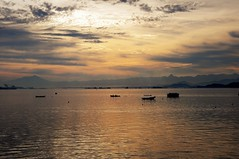 yeah... I need to go back (Ruby Augusto) Tags: bay baía sunset pôrdosol boats barcos montains montanhas clouds sky nuvens layers