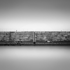 (Paul Evans.) Tags: water sea harbour wall pier jaws mono black white bw lng slow exposure nd defence