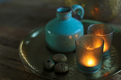 Waiting for you... (eleni m) Tags: stilllife vase plate table seaurchins tealights candleholder dof bokeh circles