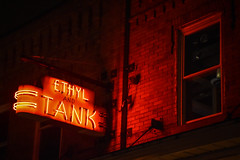 Ethyl and Tank (tim.perdue) Tags: ethyl tank bar neon sign red letters light reflection brick wall window osu campus ohio state university columbus north high street nikon d5600 nikkor 18140mm