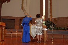 """Mrs. Morton and Mrs. Miller Lighting the Family Candles • <a style=""""font-size:0.8em;"""" href=""""http://www.flickr.com/photos/109120354@N07/46054213012/"""" target=""""_blank"""">View on Flickr</a>"""