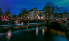 Amsterdam - Prinsengracht Blues (oliver.herbold) Tags: prinsengracht amsterdam holland netherland grachten grachtengordel bluehour bridges arches water boat traffic sky light blue lighting reflection longexposure wbpa oliverherbold