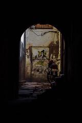 Krishna in Darkened Alleyway, Varanasi India (AdamCohn) Tags: adam cohn ganga ganges india krisha uttarpradesh varanasi alley alleyway graffiti motorbike streetphotographer streetphotography trident wwwadamcohncom adamcohn