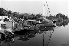 docked boats and marina in Palaio Faliro (Georgios A.V.) Tags: zenitem autorevuenon3528 orwoun54 ilfordrapidfixer r09oneshot 00320161215