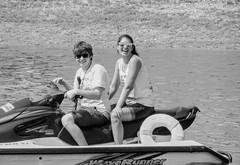 Wave Rider (clarkcg photography) Tags: couple man woman water fun summer blackandwhite blackwhite bw candid shades sunglasses reflection