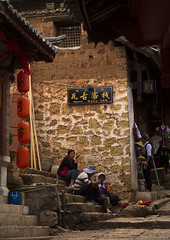 People In Old Town, Lijiang, Yunnan Province, China (Eric Lafforgue) Tags: a0007651 asia china chinesescript colorpicture dayantown fourpeople fourpersons lantern realpeople shop street unescoworldheritagesite vertical yunnan yunnanprovince lijiang